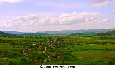 aerial view on small town in countryside summer season mountains landscape on the background view beautiful sky