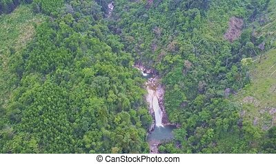 Drone Flies High above Green Hills with River Waterfalls -...