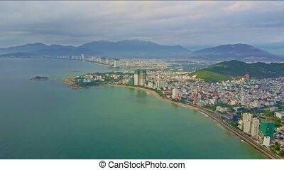Drone Flies over Azure Sea Coast with Modern Resort City