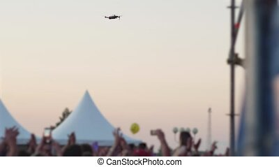 drone flies over crowd of people shooting music concert