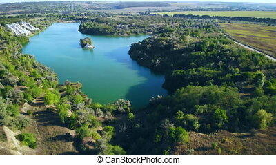 drone flies over pond - aerial view lake with blue water ...