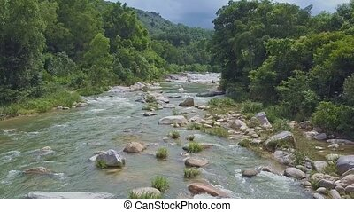 Drone Flies over River against Pictorial Nature Cloudy Sky -...