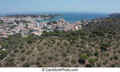 Drone flight from Cadaques over mountain hills - Aerial view...