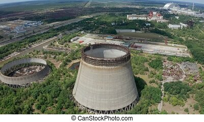 Drone flight over cooling towers near power plant - Aerial...