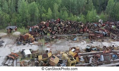 Drone flight over pile of rusty scrap in Chernobyl - Aerial...