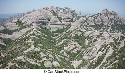 Drone flight over saw mountain range of Montserrat - Aerial...