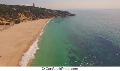 Drone flight over Spanish coast with lighthouse