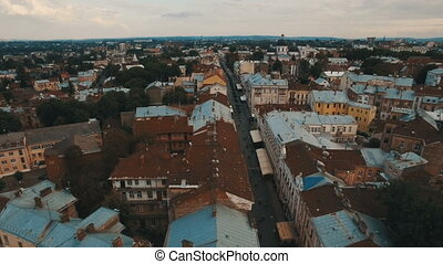 Drone flight over the rusty roofs of the old city. Chernivtsi Ukraine