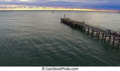 Drone flight over the sea pier with beacon beautiful sescape...