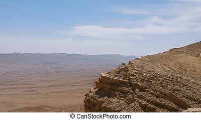Drone fly from cliff over Makhtesh Ramon crater - Drone...