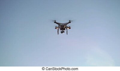 Drone flyes in the sky and landing to hands