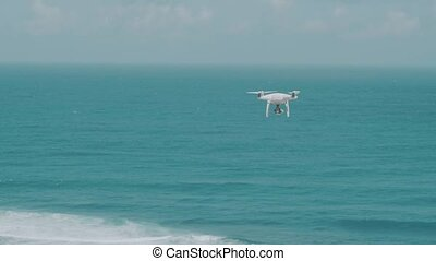 Drone flying above beautiful ocean