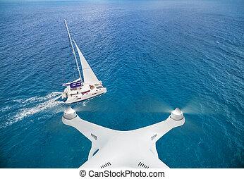 Drone flying above catamaran