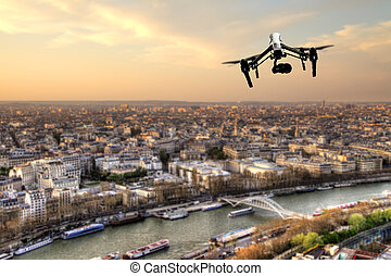 Drone flying above Paris city panorama in sunset