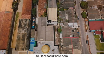 Drone flying above the coast line of Colombo, Sri Lanka. Aerial view of ocean, railroad, street traffic and buildings.