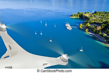 Drone flying above yachts - Drone flying above group of ...