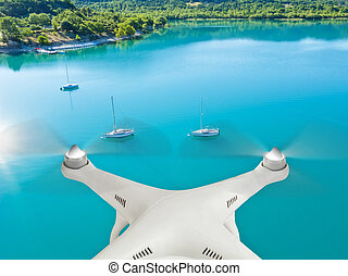 Drone flying above yachts
