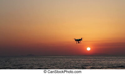 Drone flying against sunset sky - Remote controlled drone...