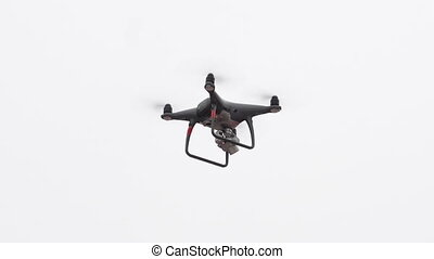Drone flying aganst white background