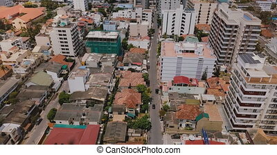 Drone flying backwards over the town of Colombo, Sri Lanka....