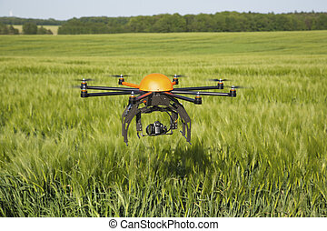 Flying drone in field -field in Germany