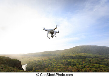 drone flying in the air over autumn forest