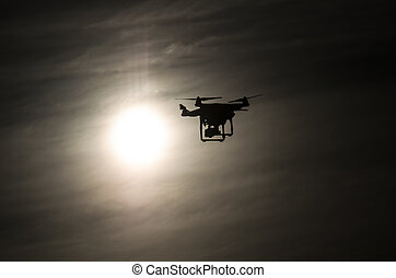 Drone flying into the sun