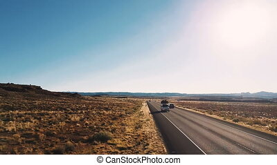 Drone flying low above typical American desert highway...