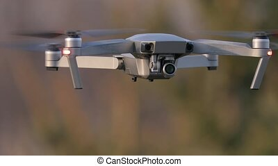 Drone flying outdoors - Drone flying closeup shot outdoors