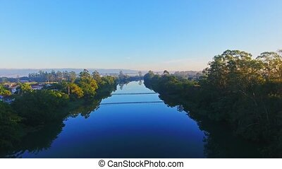 Drone Flying Over a River