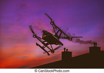Drone flying over a sunset sky with light clouds Heavy lift quadrocopter fly photographing city