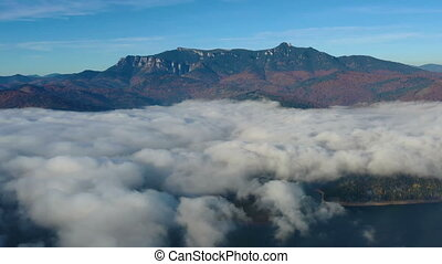 Drone flying over mist cloud in autumn morning, beautiful ...