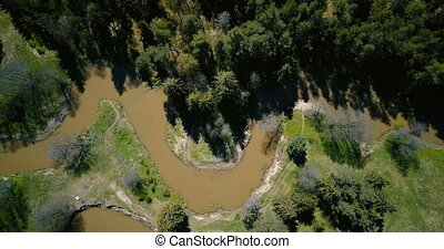 Drone flying over wild forest dirty winding river. Aerial...