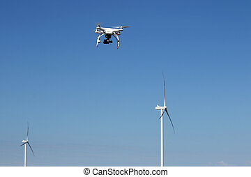 drone flying over wind turbines