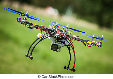 Remote drone flying with video camera on board.