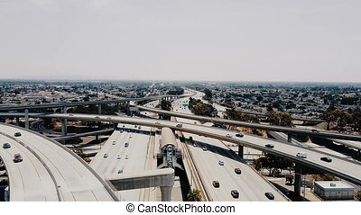 Drone flying right above incredible highway Judge Pregerson junction intersection with multiple road levels and flyovers. Amazing aerial skyline panorama of architecture transportation landmark.