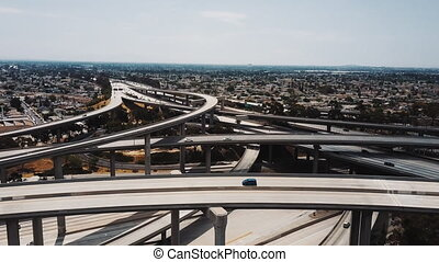 Drone flying right over multiple levels of epic highway...