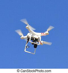 Flying uav Quadrocopter with camera
