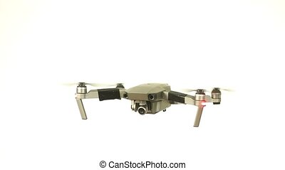 Drone flying white background - Quadcopter drone flying...