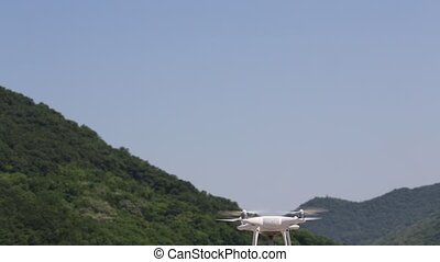 Drone flying with clear blue sky with mountain - White...