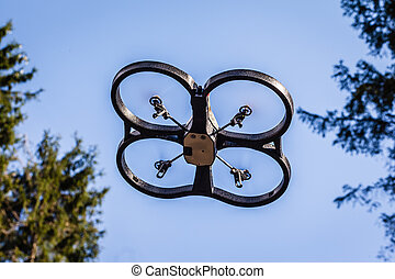 Drone fun - a small spy quad copter scout drone flying...
