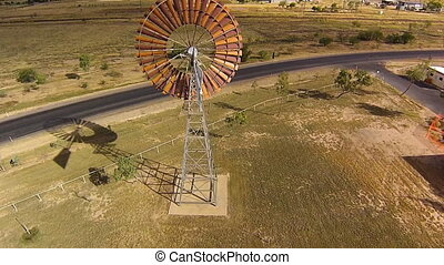 Drone getting close to a windmill - An aerial drone shot of...