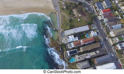 Drone gliding through Bondi beach capturing the waves - A ...