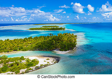 Drone image of Rangiroa atoll island reef motu in French...