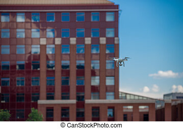 Drone in front of a building