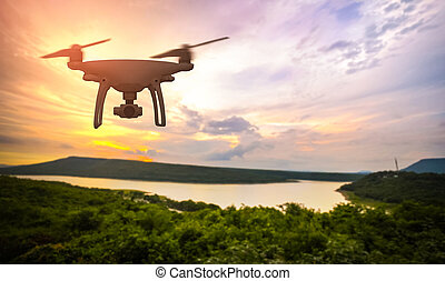 Drone in the sky at colorful sunset on Lake Hill.