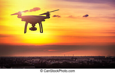 Drone in the sky at sunset. over the evening city.