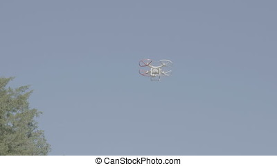 Drone in the sky filming a scene. Technology and aerial...