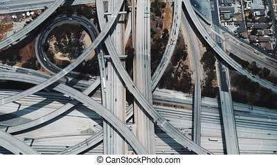 Drone lockdown shot of amazing busy Judge Pregerson highway interchange with multiple level flyovers and junctions in Los Angeles, USA. Aerial top view of architecture masterpiece with traffic.