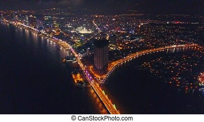 Drone Moves from Skyscraper to Bay Bridge in City at Night